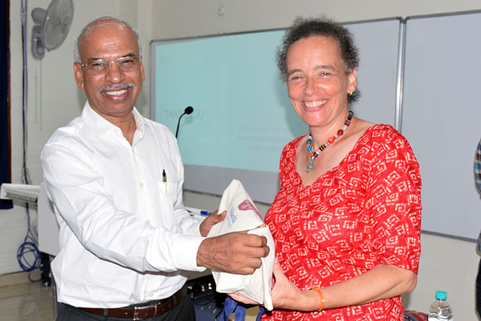 Prof. B Mohan presenting token of thanks to Dr. Maria